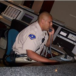 Picture of an employee working at the General Services security desk.